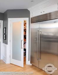 a frosted pantry door adds a stylish element to this gray and