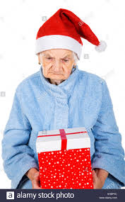 what to get an elderly woman for christmas picture of an elderly woman holding a christmas gift stock photo