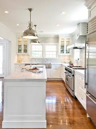 white kitchen cabinets with gray kitchen island transitional