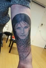 pretty face pointbreak tattoo