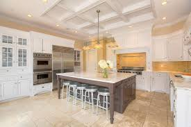 traditional space with travertine tile floors u0026 painted cabinets