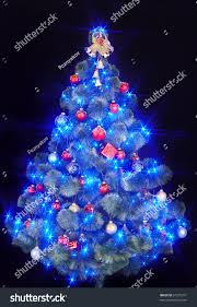 christmas tree light blue star black stock photo 67215211