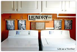 Diy Laundry Room Decor Hang Pictures In Laundry Room Using Pant Hangers For The