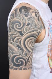 black and grey japanese cloud on right half sleeve tiger