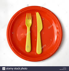 children u0027s plastic plate with yellow knife and fork stock photo