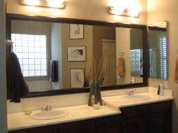 bathroom double sink vanity with mirrormate and wall sconces for