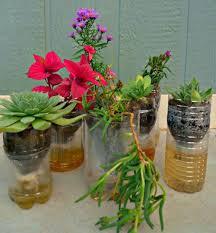 diy self watering herb garden 8 diy self watering planters using plastic bottles gardenoholic