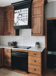 paint your oak kitchen cabinets white subway tile and oak cabinets an artist s about