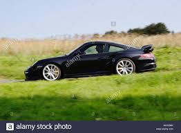 porsche side view low angle profile side view of a black porsche 911 997 turbo