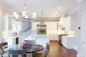 Hanging Chandelier Over Table by Design Dilemma Coordinating Kitchen Island And Breakfast Nook