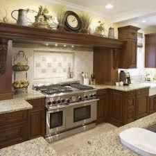 above kitchen cabinet decor ideas ceiling decorating above kitchen cabinets top of cabinet decorative