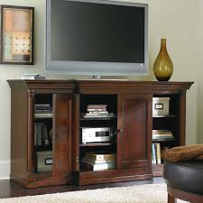 elegant tall media chest homesfeed wooden tall media chest with triple doors grey tv and fur rug