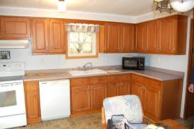 how to refinish cabinets golden oak cabinets can be stained