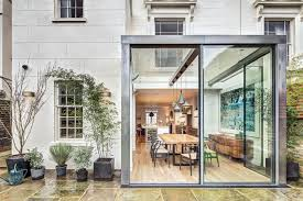 modern steel and glass rear extension of a victorian semi detached