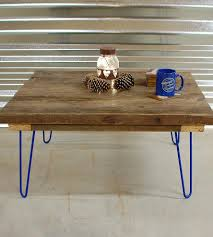reclaimed barn wood coffee table with blue hairpin legs features
