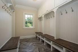cottage mud room with sandstone tile floors crown molding in