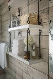 best images about organization pinterest cabinets much better than the cookie cutter shelving cabinets clever hanging storage maximizes space hgtv smart home universal design bathroom