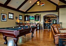 pool table in living room living room with pool table in beige and