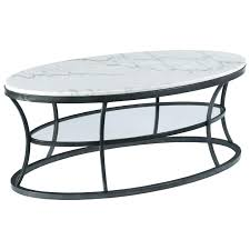 hammary impact oval cocktail table with marble top and glass shelf