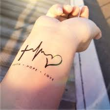 tattoo finger hope 2pcs faith love hope heartbeat tattoo inknart por inknart en etsy