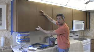 How To Paint Wooden Kitchen Cabinets How To Paint Your Kitchen Cabinets To Look As Good As New Youtube