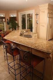 beautiful kitchen island with raised bar top in giallo fiorito 3