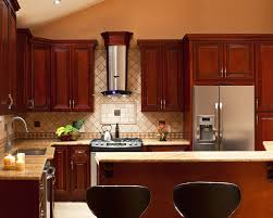 brown varnished cherry wood kitchen cabinet and kitchen island