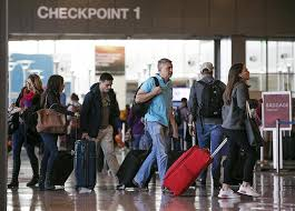 photos busy pre thanksgiving travel at airport on nov 22