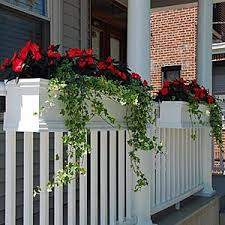 love this look flower boxes that can be attached to railings