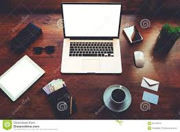 stylish office young designer on the table is open laptop cash