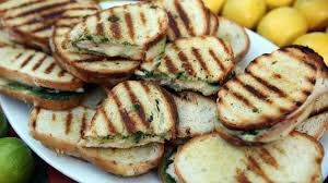 emeril s pressed roast turkey pesto and provolone sandwiches