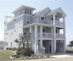 narrow waterfront house plans coastal beach house plans 4 bedrooms 4 covered porches beach