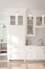 shaker kitchen cabinet doors with glass white shaker kitchen cabinets with a custom matching fridge