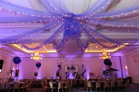 wedding arches decorated with tulle ceiling swags for wedding ceremony party ideas