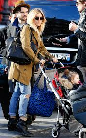 cool biker boots vogue daily u2014 sienna miller toting a marc jacobs diaper bag baby