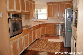 Kitchen Cabinet Resurface Pennies Per Door Its Overflowing - Kitchen cabinet trim