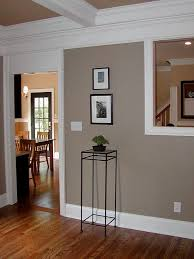 might like this for the living room and entry hall wall color brandon beige benjamin moore with white trim and black doors