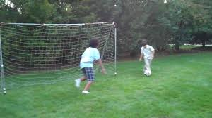 three kids playing soccer in backyard youtube