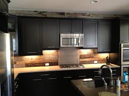 barn board siding is a great choice for the backsplash and trim in