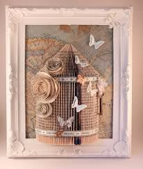 pele mele grillage birdcage book folding frame with butterfly and map image with a