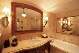 amazing bathroom with large mirrors and wall sconces also drop in