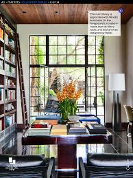 hollywood home library with minotti chairs and jean de merry table