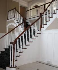 Staining Banister Flared Stairs Flared Staircase With Carpeted And Stained Stairs
