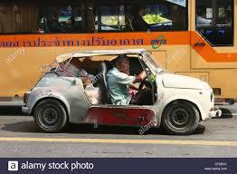 rattletrap car a fully loaded old car and a modern bmta bangkok metropolitan
