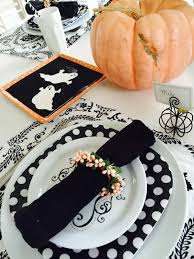 halloween plates peach black and white halloween tablescape the style sisters
