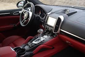 black porsche red interior 2015 porsche cayenne s cars suv black wallpaper 1920x1280