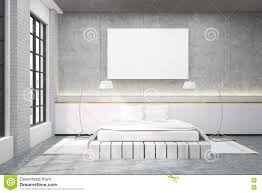 master bedroom with a double bed a poster and two lamps stock
