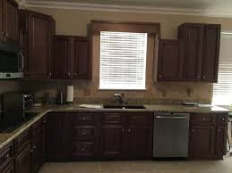 staining kitchen cabinets darker before and after lighter brighter kitchen cabinets how to update your