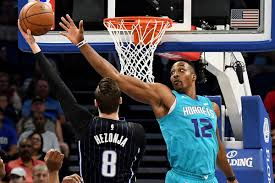 basketball player on bench hornets 137 magic 100 hornets sweep magic in decisive fashion