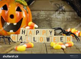 happy halloween with no background happy halloween wooden blocks candy corn stock photo 318279341